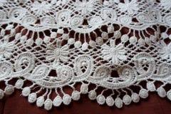 Margin of lace on auburn fabric Stock Photo