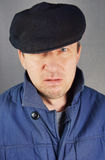 Marginal man in a cap Royalty Free Stock Photography