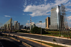 Marginal Pinheiros Sao Paulo Brazil. The Estaiada pensil bridge with its steel cables and the modern glass windows towers, an electrical power line tower and a stock photos