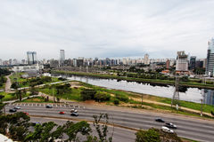 Marginal Pinheiros Sao Paulo Brazil. Marginal Pinheiros avenue at the first plane,Pinheiros river waters and the modern neighbourhoods in the back, Via Funchal royalty free stock photos