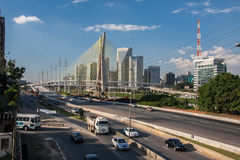 Marginal Pinheiros Sao Paulo Brazil. The Estaiada pensil bridge with its steel cables and the modern glass windows towers, an electrical power line tower and a stock images