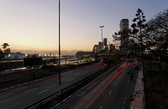 Marginal in Sao Paulo by Night. The main road Marginal Pinheiros at Sao Paulo at dusk. Several modern and tall buildings and the traces of the car lights royalty free stock images