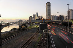 Marginal in Sao Paulo by Night. The main road Marginal Pinheiros at Sao Paulo at dusk. Several modern and tall buildings and the traces of the car lights. At stock photos