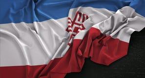 Mari El Flag Wrinkled On Dark-3D de Achtergrond geeft terug Stock Afbeeldingen