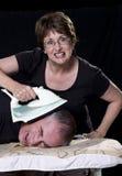 Mari et épouse avec du fer Image stock