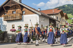 Maria Ascension procession Oberperfuss, Austria. OBERPERFUSS, AUSTRIA - AUG 15: Villagers dressed in their finest traditional costumes during Maria Ascension Royalty Free Stock Photography