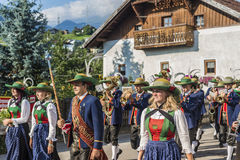 Maria Ascension procession Oberperfuss, Austria. OBERPERFUSS, AUSTRIA - AUG 15: Villagers dressed in their finest traditional costumes during Maria Ascension Stock Images