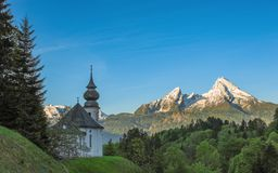 Maria Gern chapel and snow-capped peaks of Watzmann mountain Royalty Free Stock Images