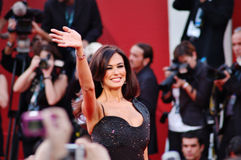 Maria Grazia Cucinotta says hallo. Maria Grazia Cucinotta smiling and saying hallo on the red carpet for the official awards Stock Image