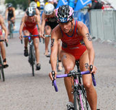 Maria Ortega front view cycling in the triathlon event Stock Photos