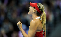 Maria Sharapova. Is celebrating good shoot in the match with Agnieszka Radwanska in Fed Cup in Krakow in Polnad Royalty Free Stock Photography