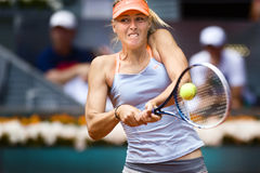 Maria Sharapova dans l'action pendant le tennis de Madrid Mutua ouvert Image stock