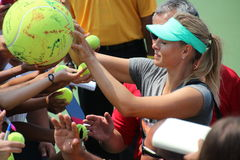 Maria Sharapova. Professional russian tennis player Maria Sharapova signing autographs during her practice session at the 2013 US open tennis tournament Royalty Free Stock Photos