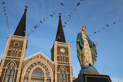 Maria statue with old church background. Royalty Free Stock Photography