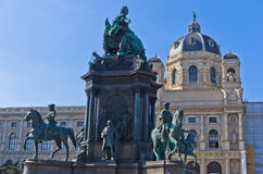 Maria Theresa statue in a garden with a lot of historical figures around her in front of Art History museum in Vienna Royalty Free Stock Photo