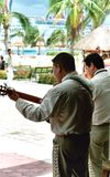Mariachi. Band with cruise ship in the background royalty free stock photography