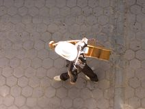 Mariachi from above. Mariachi band member from above walking down brick street in puerto nuevo, baja california norte, mexico stock photos