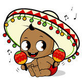 Mariachi baby boy playing the maracas Stock Photo