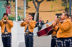 Mariachi band play mexican music. Mexico City - December 03, 2016 : Mariachi band play mexican music at Garibaldi Square in Mexico City, Mexico Royalty Free Stock Photos