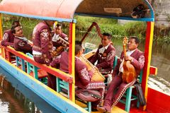 Mariachi band play mexican music. A mariachi band performs on a Trajinera boat at Xochimilco a popular tourist attraction near Mexico City stock photos