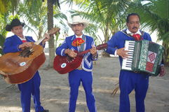 Latin American Folk ensemble at the beach Stock Photo