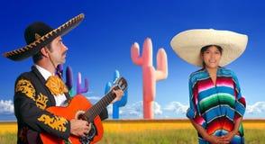 Mariachi charro playing guitar mexican poncho girl. Cactus Mexico Stock Image