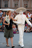 Mariachi clown with a girl from audience Stock Images