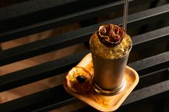 Mariachi cocktail on bar table. Freshness alcoholic beverage drink with Tequila, Luxardo, Grapefruit juice, Kurkuma syrup, Egg white ingridients, close-up Royalty Free Stock Image