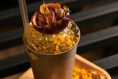 Mariachi cocktail on bar table. Freshness alcoholic beverage drink with Tequila, Luxardo, Grapefruit juice, Kurkuma syrup, Egg white ingridients, close-up Stock Photo