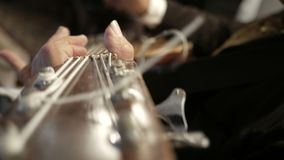 Mariachi, der Bass-Gitarre spielt stock video footage