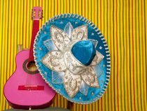 Mariachi embroidery mexican hat pink guitar Stock Photo