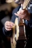 Mariachi Guitar Player. Detail of hispanic Mariachi guitar player strumming his guitar strings Royalty Free Stock Images