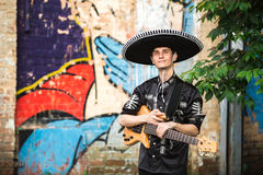 Mariachi  with a guitar on the street Royalty Free Stock Photos