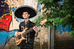 Mariachi  with a guitar on the street Stock Photo