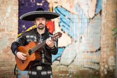 Mariachi  with a guitar on the street Royalty Free Stock Photography