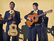 Mariachi Street Musicians, California. Teenage musicians in traditional clothing perform mariachi music, a genre of music from Mexico, on a street during a Royalty Free Stock Image
