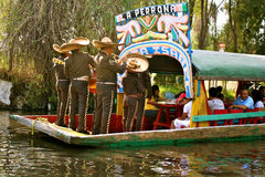 Mariachis on boat in Xochimilco, Mexico