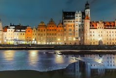Mariacka Gate and other sights of Gdansk on the bank of the Motlawa, evening view.  stock images