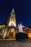 Mariacki church with angel in christmas night. Katowice Royalty Free Stock Photo