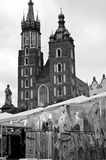 Mariacki Church in Cracow. Cracow Krakow Poland - Mariacki church or cathedral in the background with private business stand selling regional clothing and Royalty Free Stock Images