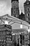Mariacki Church in Cracow. Cracow Krakow Poland - Mariacki church or cathedral in the background with private business stand selling regional clothing, textiles Stock Image