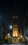 Mariacki church in Katowice with moon in the night. Poland Stock Images
