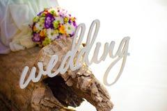 Mariage, bouquet et anneaux de Word Image stock