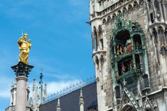 The Marian Column and the Clock chimes at the Marienplatz stock photos