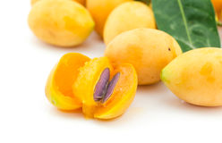 Marian plum slice isolated on white background. Marian plum slice isolated on white Royalty Free Stock Images