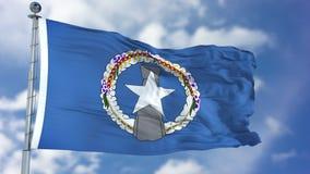 Mariana Islands Flag du nord dans un ciel bleu Images stock