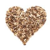 Marianum orgânico do Silybum da semente do cardo de leite na forma do coração imagens de stock royalty free