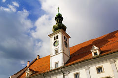 Maribor - old town hall. Old Town Hall (Rotovz) at Main Square (Glavni trg) of the city of Maribor. Sunset light during evening stock photos
