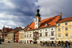 Maribor - Town hall. OLD TOWN HALL (ROTOVZ), MAIN SQUARE (GLAVNI TRG), MARIBOR, SLOVENIA - MARCH 24, 2016: Ordinary life on the Main Square of the city of stock photos