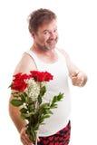 Marido con las flores de las tarjetas del día de San Valentín Imagen de archivo libre de regalías